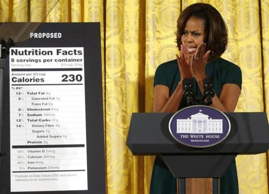 U.S. first lady Michelle Obama applauds as she unveils proposed updates to nutrition facts labels during remarks in the East Room of the White House in Washington, February 27, 2014.