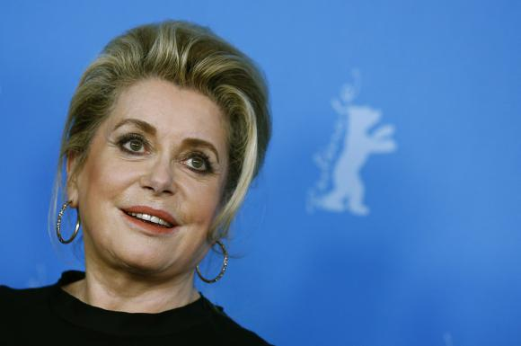 """Cast member Deneuve poses during a photocall to promote the movie """"Dans La Cour"""" at Berlinale International Film Festival in Berlin"""