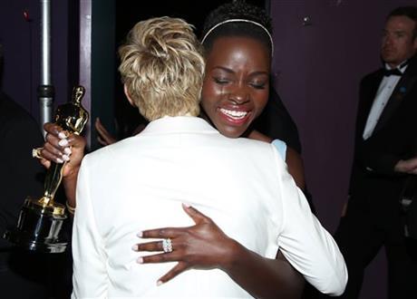 Ellen DeGeneres, left, embraces Lupita Nyong'o