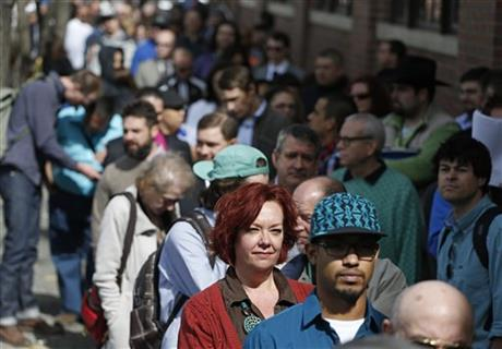 Job seekers line up in the hundreds to attend a marijuana industry job fair