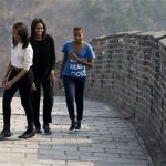 Michelle Obama walks with her daughters Malia, left, and Sasha, right