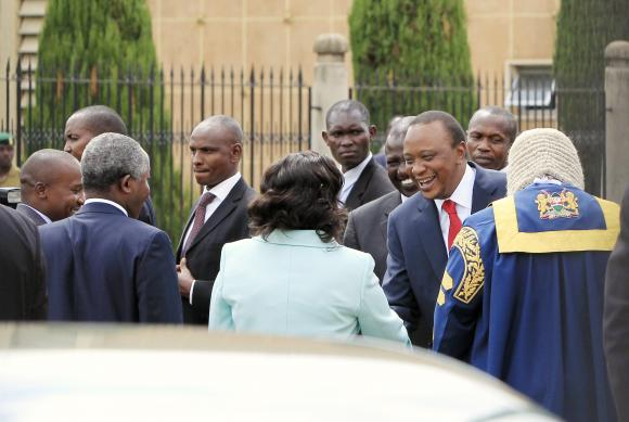 Kenyan President Kenyatta arrives at the Parliament Building to deliver his state of the nation address in Nairobi