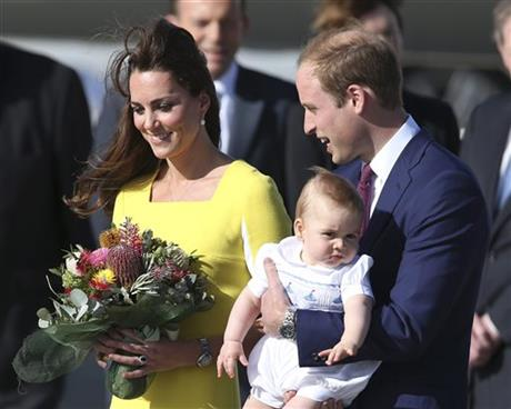 Britain's Prince William holding his son Prince George and his wife Kate