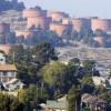 File photo of homes sitting below Chevron storage tanks on a hillside in Richmond, California