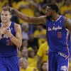 Los Angeles Clippers' Blake Griffin (32) celebrates with teammate DeAndre Jordan (6)