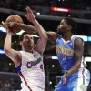 Los Angeles Clippers guard J.J. Redick, left, looks to shoot as Denver Nuggets guard Aaron Brooks