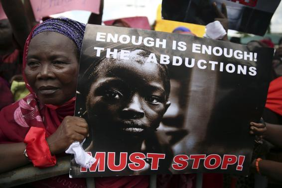 A woman holds a sign during a protest demanding the release of abducted secondary school girls from the remote village of Chibok, in Lagos