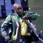President Jacob Zuma dances at a victory rally of his ruling African National Congress (ANC) in Johannesburg