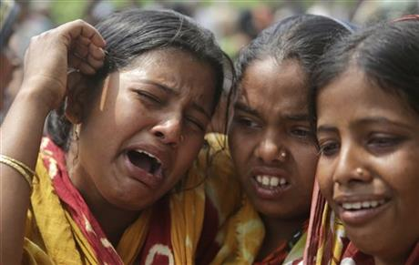 Relatives of victims killed in ethnic violence mourn