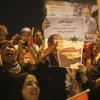 Supporters of Sisi hold a poster of him as they celebrate at Tahrir square in Cairo