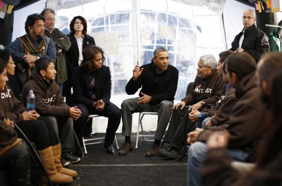 File photo of President Barack Obama and first lady Michelle Obama meeting with protesters fasting for immigration reform in a tent on the Washington Mall