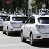 a row of Google self-driving cars