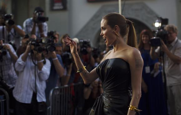 """Cast member Jolie waves at the premiere of """"Maleficent"""" at El Capitan theatre in Hollywood"""