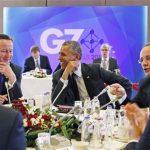 Barack Obama, center, laughs as he looks at British Prime Minister David Cameron, left, with French President Francois Hollande