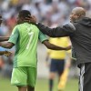 Nigeria's coach Stephen Keshi, right, and teammate Juwon Oshaniwa, left, congratulate Ahmed Musa