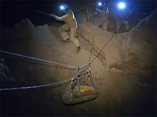 Still image taken from video of rescuers helping injured researcher Westhauser inside the Riesending cave in Untersberg