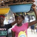 Twelve-year-old, Kemi Olajuwon, right