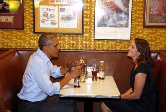 U.S. President Barack Obama visits with Rebekah Erler at Matt's Bar in Minneapolis