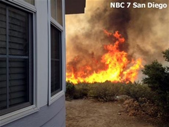 California wildfires burn homes