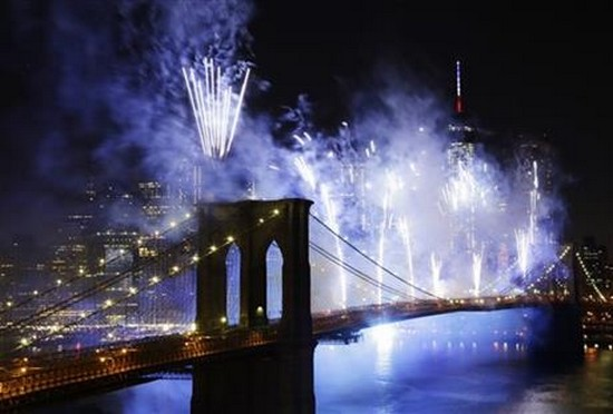 Fireworks light up the sky above the Brooklyn Bridge