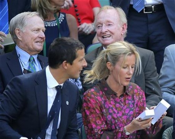 Former golfer Jack Nicklaus, rear left, and former tennis player Rod Laver, rear right,