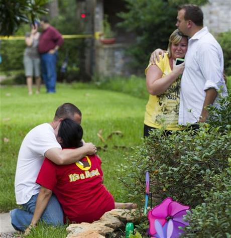 Neighbors embrace each other following a shooting Wednesday