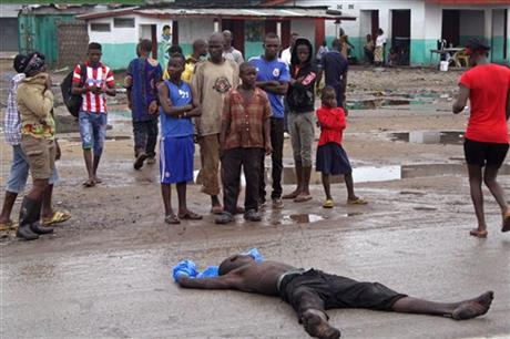 People gather around a man suspected of dying from the Ebola virus