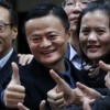 Alibaba Group Holding Ltd founder Jack Ma poses as he arrives at the New York Stock Exchange for his company's initial public offering in New York