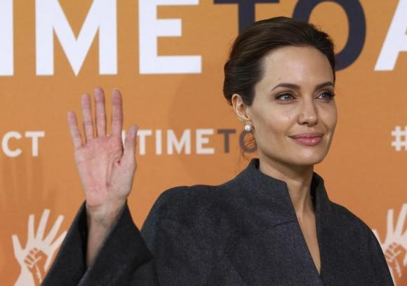 Angelina Jolie arrives at a summit to end sexual violence in conflict, at the Excel centre in London