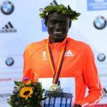 Kimetto of Kenya celebrates during the awards ceremony for the 41st Berlin marathon