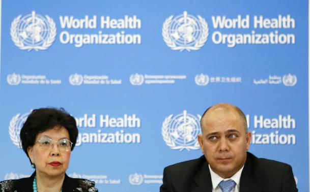 Chan pauses next to Ojeda during a news conference in Geneva