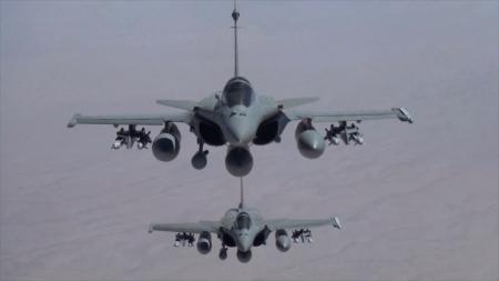 Handout shows two French Rafale fighter jets flying in formation during a mission from the Al-Dhafra airbase