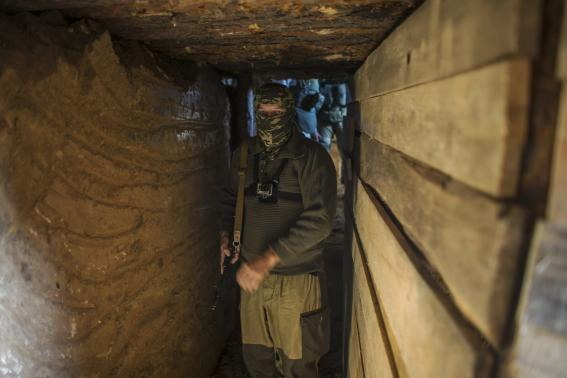 "An American who calls himself ""Hunter"" walks inside a bunker near the town of Yasynuvata"
