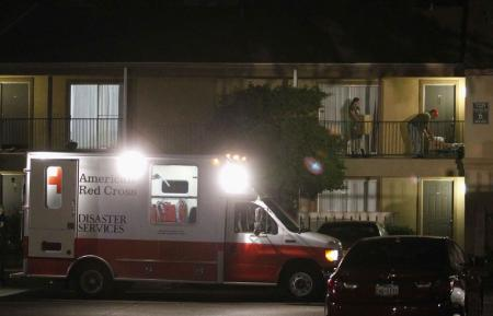 A Red Cross worker delivers bedding materials to an apartment unit at The Ivy Apartments, where a man diagnosed with the Ebola virus was staying in Dallas, Texas