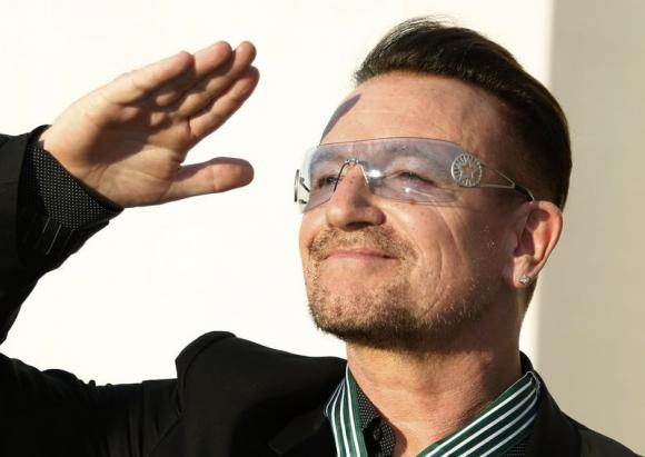 Bono reacts after being awarded Commander in the Order of Arts and Letters during a ceremony in Paris