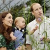 Britain's Catherine, Duchess of Cambridge, carries her son Prince George alongside her husband Prince William as they visit the Sensational Butterflies exhibition at the Natural History Museum in London