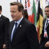 British Prime Minister Cameron arrives for the Asia-Europe Meeting at the congress center in Milan