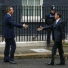 Britain's Prime Minister David Cameron greets his French counterpart Manuel Valls as he arrives at Number 10 Downing Street in London