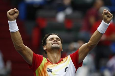 David Ferrer of Spain celebrates winning his men's singles tennis match against Andy Murray of Britain at the Shanghai Masters tennis tournament in Shanghai