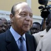 Haiti's former dictator Duvalier moves through the crowd of supporters, journalists and security after he was discharged from a private hospital in Port-au-Prince
