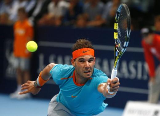 Spain's Rafael Nadal returns the ball to Simone Bolelli of Italy during their tennis match at the Swiss Indoors ATP tournament in Basel