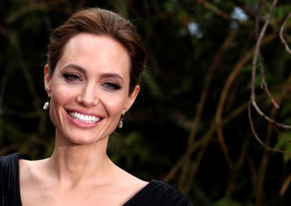File photo of actress Angelina Jolie arriving for a special Maleficent Costume Display at Kensington Palace in London