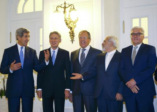 U.S. Secretary of State Kerry, Britain's Foreign Secretary Hammond, Russian Foreign Minister Lavrov, Iranian FM Zarif and German FM Steinmeier pose for photographers before a meeting in Vienna