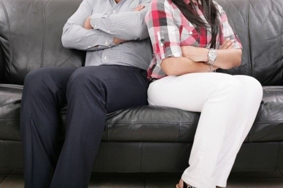 Couple Sitting Of The Couch Having Problems In Their Relationshi - by David Castillo Dominici
