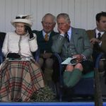 Britain's Queen Elizabeth and Prince Charles watch the sack race at the annual Braemar Highland Gathering in Braemar, Scotland