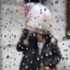 People walking under an umbrella