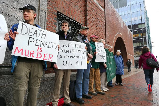 Demonstrators against capital punishment outside federal court
