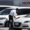 An employee wipes the surface of a car on display at a Honda dealer in Kawasaki, south of Tokyo
