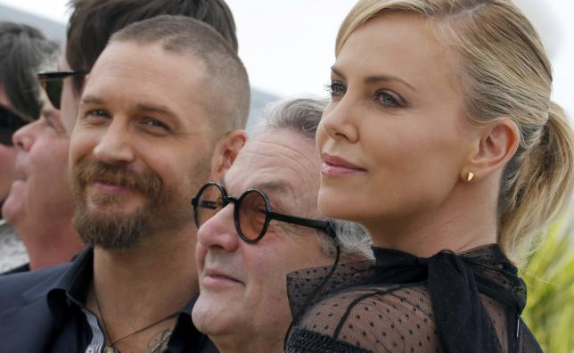 """Director George Miller, cast members Tom Hardy and Charlize Theron pose during a photocall for the film """"Mad Max: Fury Road"""" out of competition at the 68th Cannes Film Festival in Cannes"""