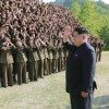 KCNA picture shows North Korean leader Kim Jong Un waving during an inspection at the commanding headquarters of the 264 Combined Forces